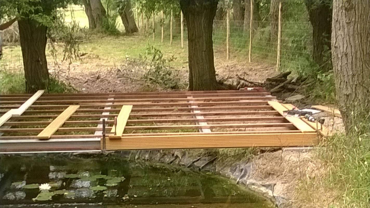 Realisaties van werken in nieuwpoort veurne diksmuide en for Vijver afwerking hout